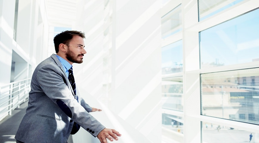 Finance Director by glass windows